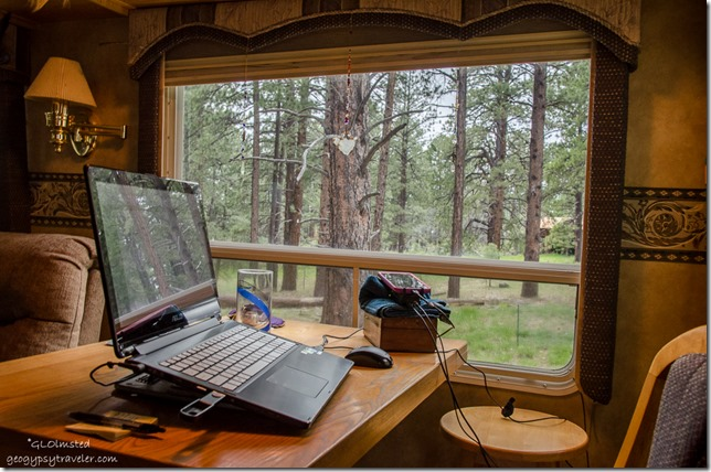 Laptop on table & forest view North Rim Grand Canyon National Park Arizona