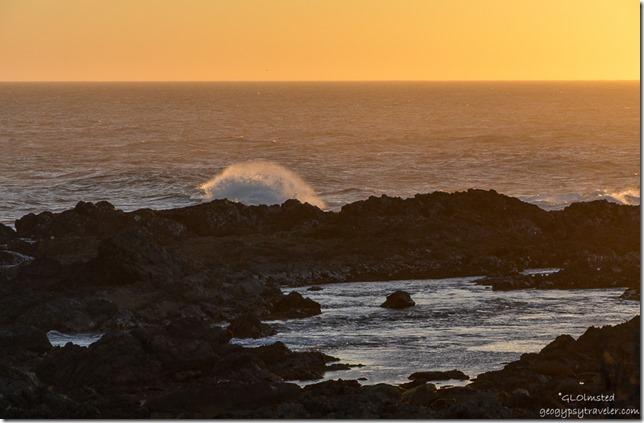 Sunset crashing waves on rocky coast Indian Ocean Tsitsikamma National Park South Africa