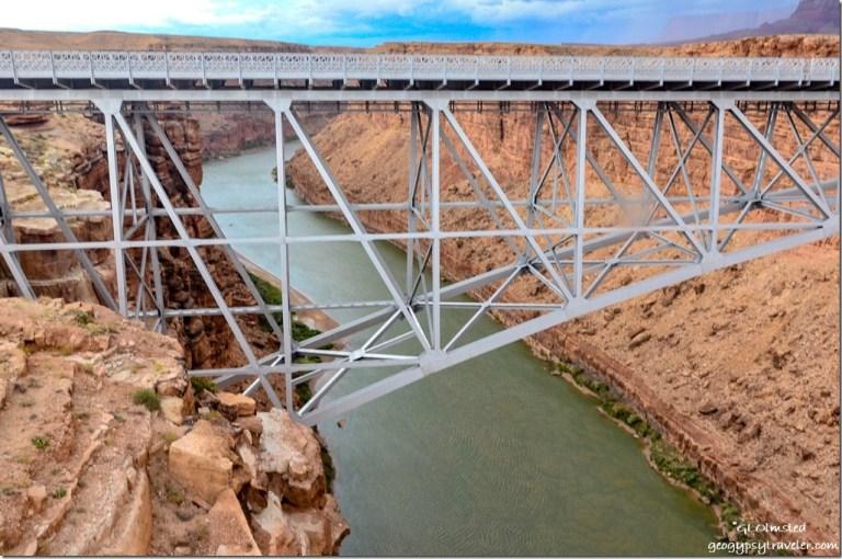Muddy Paria River mixing with Colorado River from Navajo Bridge Marble Canyon Arizona