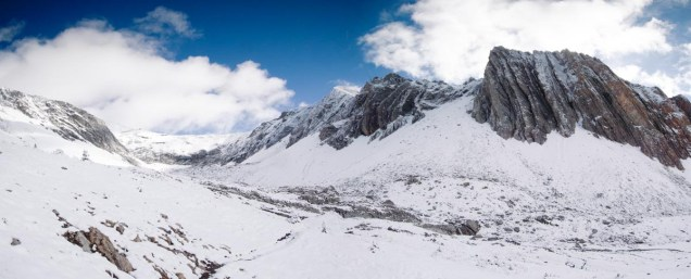 """Mount Arethusa dominates the skyline from this position in the lower reaches of Ptarmigan Cirque. Large """"steps"""" mark the gradual elevation loss down through the cirque and a couple of larger steps feature nice waterfalls. The approach to Mount Rae is around the corner from the bluff on the left."""