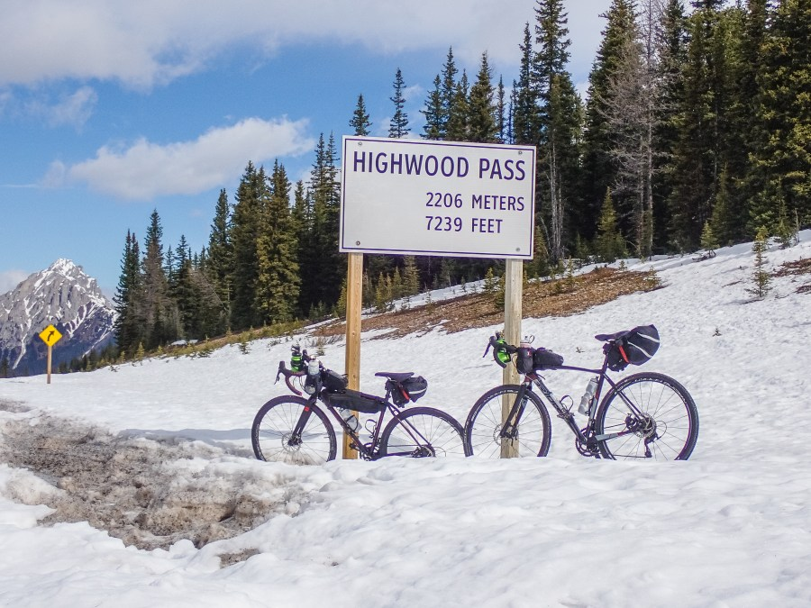 bikes-at-highwood-pass-summit-sign