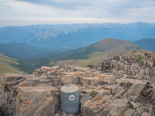 survey marker at the summit of Mount Allan