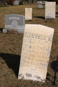 Chemical weathering of limestone and granite headstones.