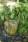 A small bamboo fountain traditionally used for drinking and washing hands. (But it's only for display.) This is located near the teahouse.