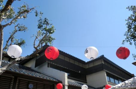 Paper lanterns with the words matsuri (festival) and luck on them.
