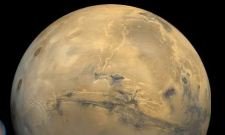 This is the largest canyon on both Mars and in the solar system, named Valles Marineris.