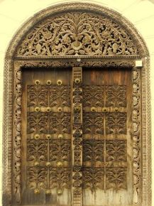 Carved wood door in Stone Town. Image from Wikipedia.org.