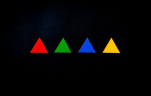 Colorful triangles on a black background