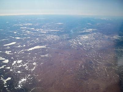 The barren, rocky, glacier-scraped upper elevations.