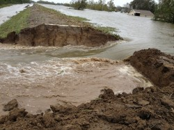 A controlled breach of a levee in Plaquemines Parish to relieve huricane Isaac's flooding in 2012