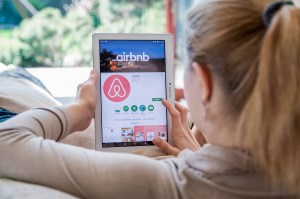 Wroclaw, Poland- April 10Th, 2017:  Woman Is Installing Airbnb A