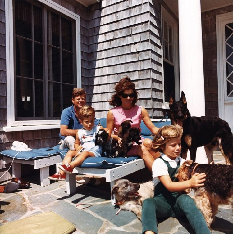 President Kennedy, John Jr., Mrs. Kennedy and Caroline Kennedy with family dogs. Hyannis Port, Squaw Island.