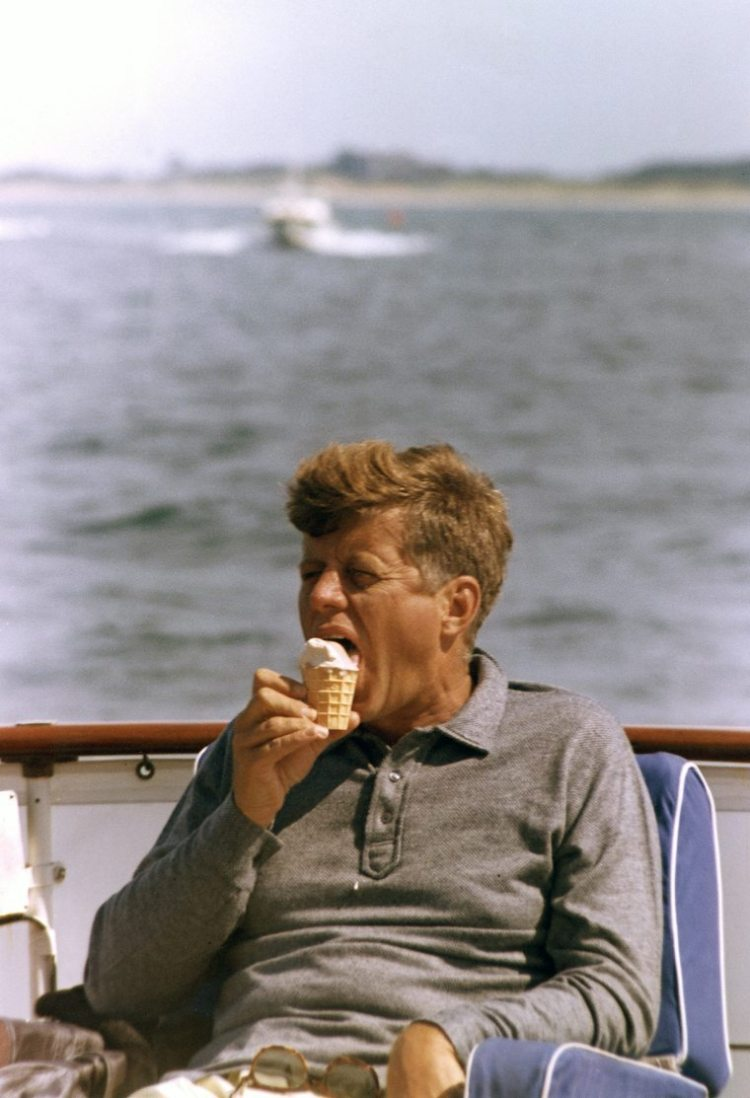 """President Kennedy aboard the """"Honey Fitz"""", off Hyannis Port, MA. Photograph by Cecil Stoughton."""