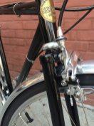 Front chrome fender, crown fork and caliper brakes.