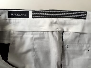 """Rubber """"grip"""" strip sewn into the waistband lining."""