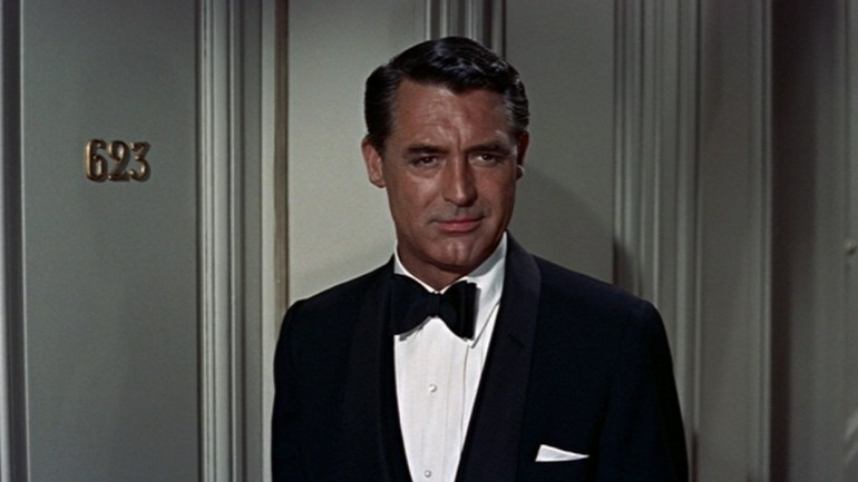 Cary Grant in a stunning midnight blue dinner jacket with a shawl collar. Costume designer Edith Head gave Grant credit for choosing most of his own clothes for the movie.