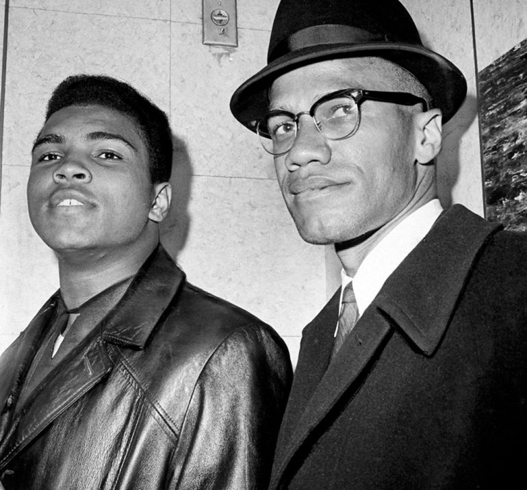 Cassius Marcellus Clay (Muhammad Ali) with Black Muslim leader Malcolm X at 125th St. and Seventh Ave.  (Photo by John Peodincuk/NY Daily News Archive via Getty Images)
