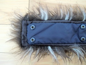 The back of the hood trim, with the new fur (brown nylon background) sewn onto the original navy blue nylon mounting strip with the buttonholes.
