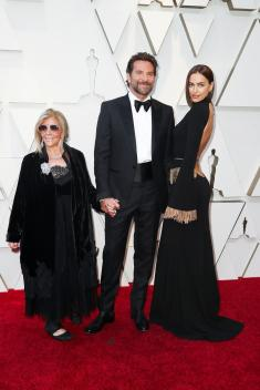 Bradley Cooper with Irina Shayk and Gloria Camp. Photo by Josh Haner/The New York Times.
