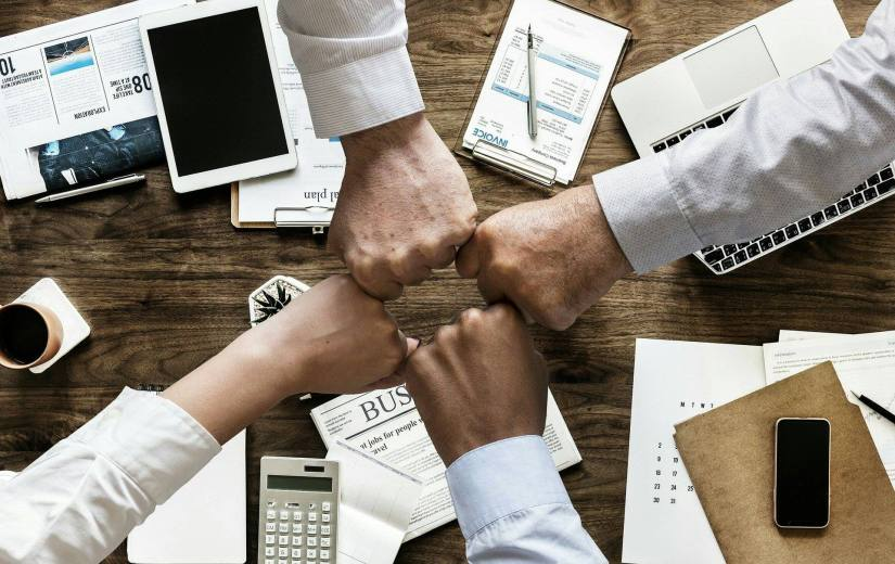 An image of people working together in a business.