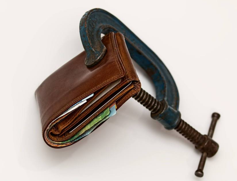 An image of a wallet clamped shut showing a scarcity relationship with money.