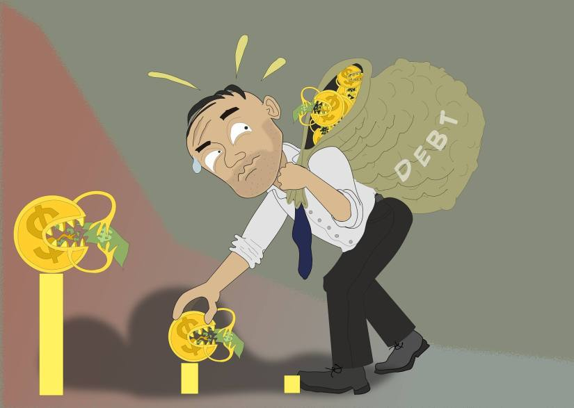 An image of a man with debt problems due to a negative relationship with money.