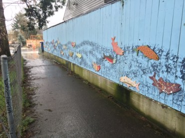A fish mural brightens a wall on a pedestrian bridge that crosses over Crystal Springs.