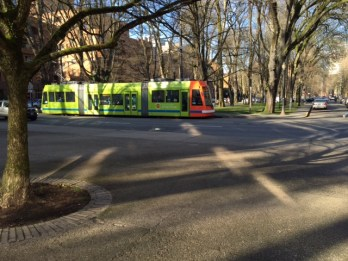 A Portland Streetcar glides quietly through the north end of the PSU campus.