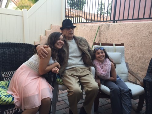 Dad flanked by great-granddaughters Justice and Jada.