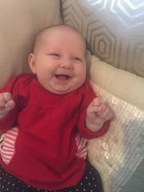 Who knew a baby could smile this easily just two months after being born?