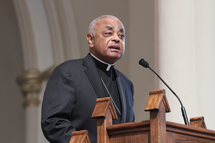 Archbishop Wilton D. Gregory stands before the congregation at the Shrine of Immaculate Conception, Atlanta, just prior to this year's annual Good Friday pilgrimage through the city's downtown streets. On July 21 Archbishop Joseph E. Kurtz of Louisville, Ky., president of the U.S. Conference of Catholic Bishops, appointed Archbishop Gregory to chair a new USCCB task force on race.