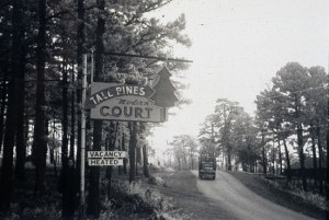 Instead, you might see signs for a tourist court like the Tall Pines along the way.