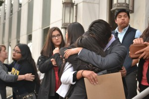 Freedom University students hug after the protest. Photo by: Christina Maxouris | The Signal