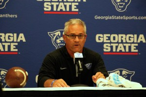 Interim Coach Lappano speaks to the media in a postgame conference.  Photo By Woody Bass   The Signal