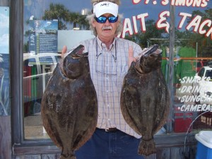 "George of  Brunswick, Ga. caught this nice pair of flounder from the St. Simons Pier last week. The biggest was a 28-inch 8-pounder, while the ""little"" one was 26 inches and 7 pounds. (Photo courtesy of St. Simons Bait and Tackle)"