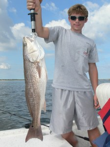 Wyatt Crews celebrated his 16th birthday by fishing at the St. Marys Jetties this week. He caught this 30-inch redfish by bouncing a morning glory Assassin Sea Shad fished on a 1/2-ounce jighead around the jetty rocks. Happy Birthday, Wyatt!