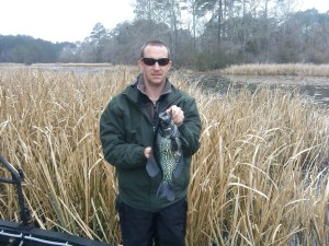 Fisheries technician Ethan Lovelace with a 2-pound crappie collected on Lake Seminole.