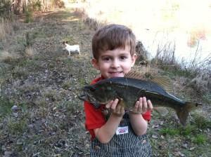 Ty Baumann was all smiles while fishing with his father, Chris, recently. They had a blast catching and releasing the dozen or so bass they caught.