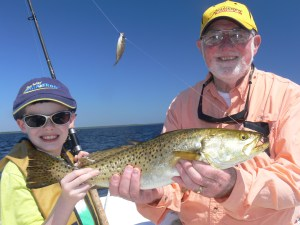 Timothy Deener (left) caught this giant 24-inch seatrout on Monday with a live baitfish suspended under a Back Bay Thunder Float. He was fishing with his grandfather, Herb Deener.