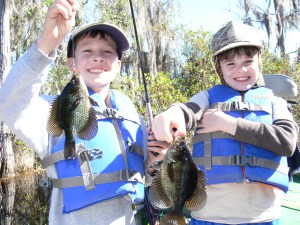 "Evan Chaney (left) and Timothy Deener ""doubled up"" on fliers in the Okefenokee Swamp last Saturday. The pair of anglers caught 15 fliers on sallies fished under a float. Evan caught his first flier during the trip."