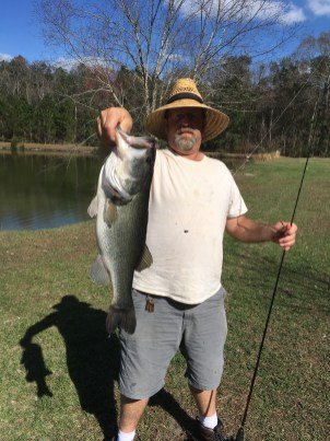 Brentz McGhin's trophy bass was caught from a Blackshear pond on a plastic worm, and he released it.