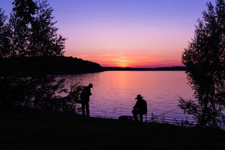 Fishing on lake. The fishers fish on the lake in night time.