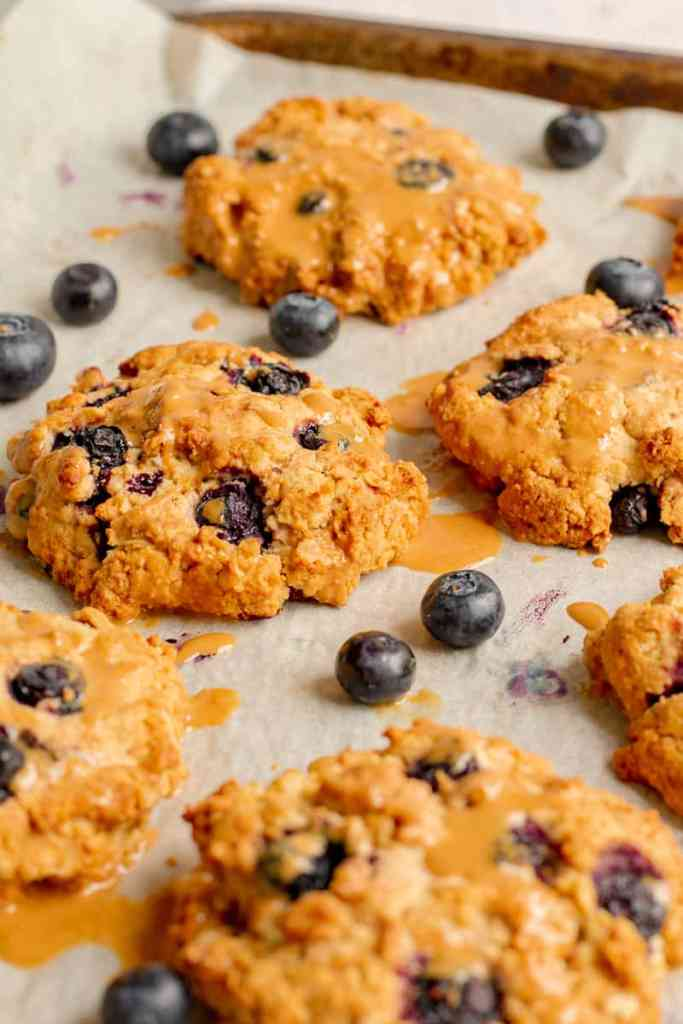 Blueberry Crumble Cookies on Baking Tray with Cashew Drizzle - Vegan, GF & Healthy! Georgie Eats.
