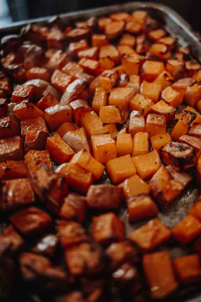 A tray of roasted butternut squash and sweet potato.
