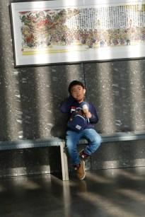 Little boy eating ice cream in Nebuta museum