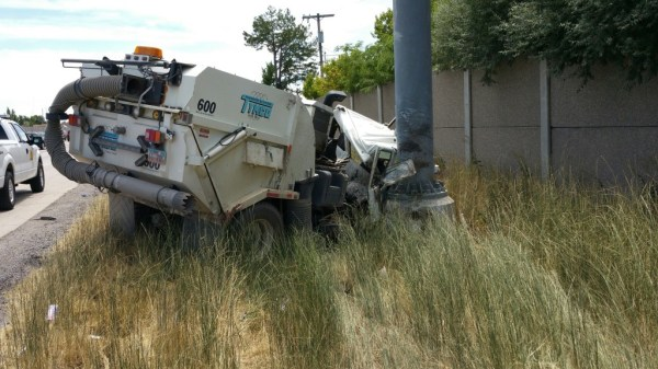 Street Sweeper Has Blowout and Collides with Pole on I215