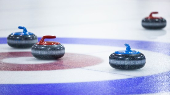 Curling rocks in play
