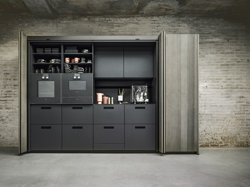 bi_fold_retractable_tall_unit_open_by_next125_luxury_german_kitchens