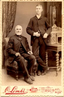 "PHOTO LATE 1880's – EARLY 1890s Joachim is shown with his grandson, John Nieman, (spelled with one ""n"") the son of Johann Niemann II. Johann appears to be about 70."