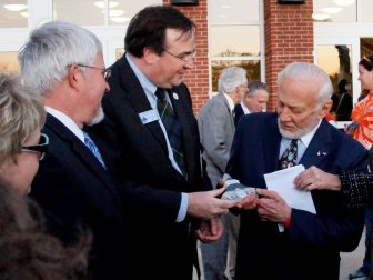 Marc Wheat presenting a reprentation of the Germanna Visitor Center to Buzz Aldrin